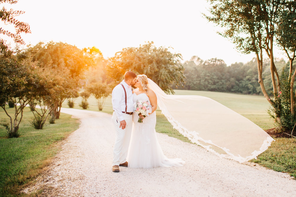 Bride and Groom Kissing in the Driveway