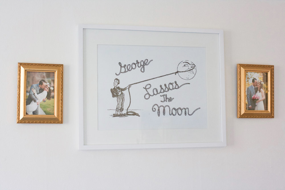 I'm still working on the wall decor but for now we have wedding photos of mommy and daddy along with the print I gifted my husband for our first anniversary--a rendition of the drawing Mary made for George in one of our favorite films  It's a Wonderful Life . It really is, isn't it?