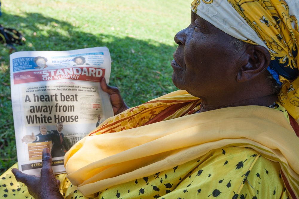 Sarah Onyango Obama reading Kenyan press coverage of the U.S. campaign at her rural homestead in Kogelo. Credit: Andy Isaacson