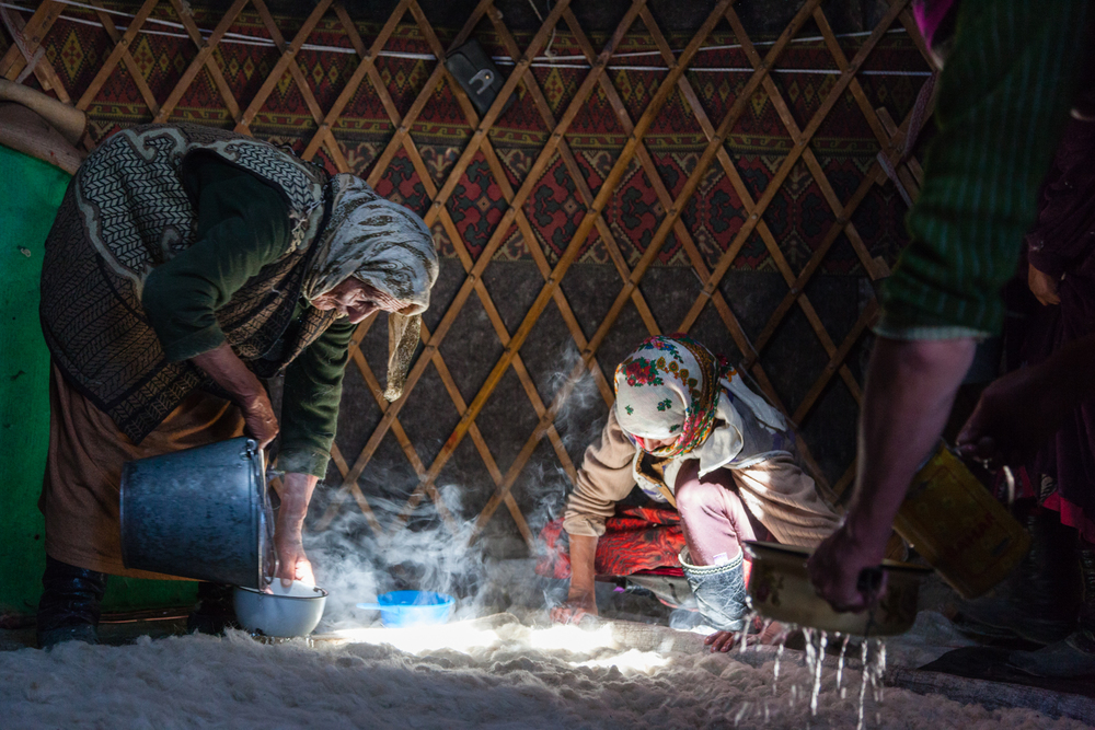 Turning wool into felt for the walls of a yurt. Credit: Andy Isaacson