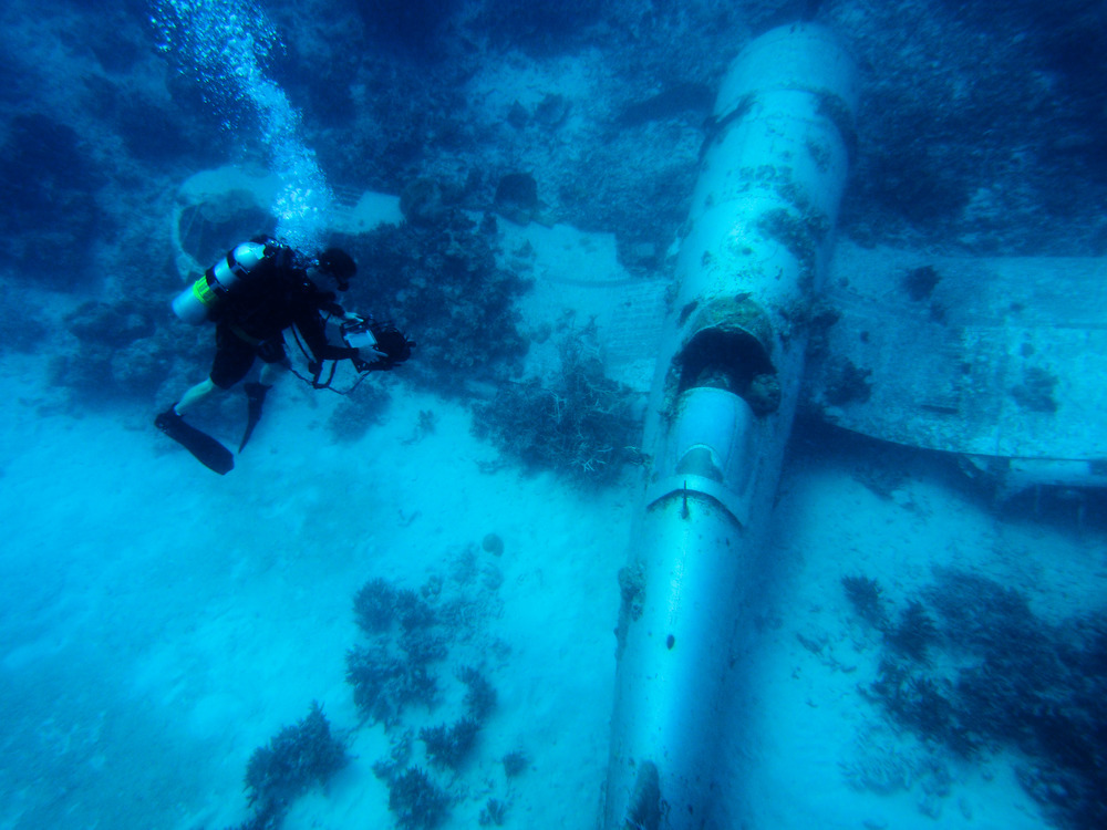 A scientist from the Scripps Institution of Oceanography dives around a sunken Corsair. Credit: Scripps