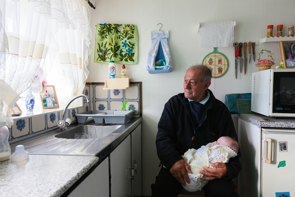 Tristan-born Harold Green holds a new family member: his great-grandchild Natasha Williams. Credit: Andy Isaacson