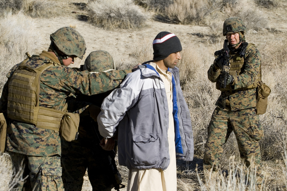 An Afghan 'villager' is searched by Marines and ANA role players. Credit: Andy Isaacson