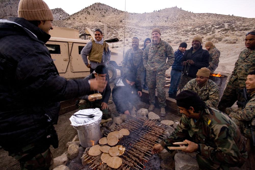 Grilling kebabs back at base camp. Credit: Andy Isaacson