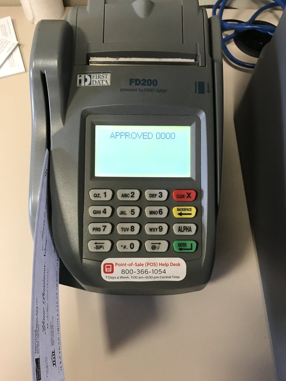 9. After a few seconds you will receive an Approved message and a receipt will print. Tear off the receipt and have the check writer sign it.