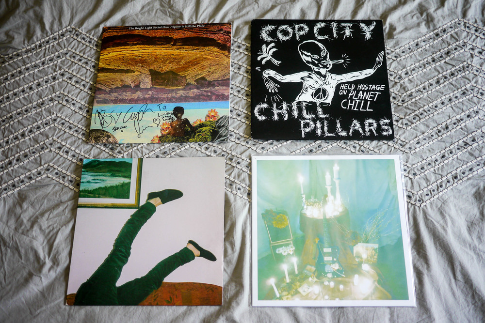 "Lindsey's Favorite Records clockwise from left:   Bright Light Social Hour ""  Space is Still the Place"",   Cop City/Chill Pillars ""  Held Hostage on Planet Chill"",   Tape Deck Mountain '  Sway' &   Twin Sister '  Vampires with Dreaming Kids'."
