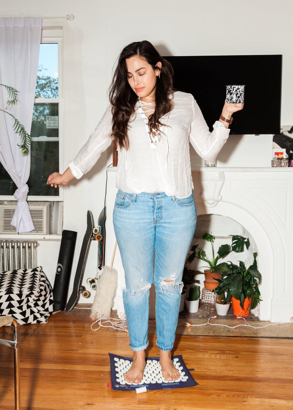 Top, Isabel Marant Etoile ; Jeans, Levi's ;Accupressure Mat, Nayoya