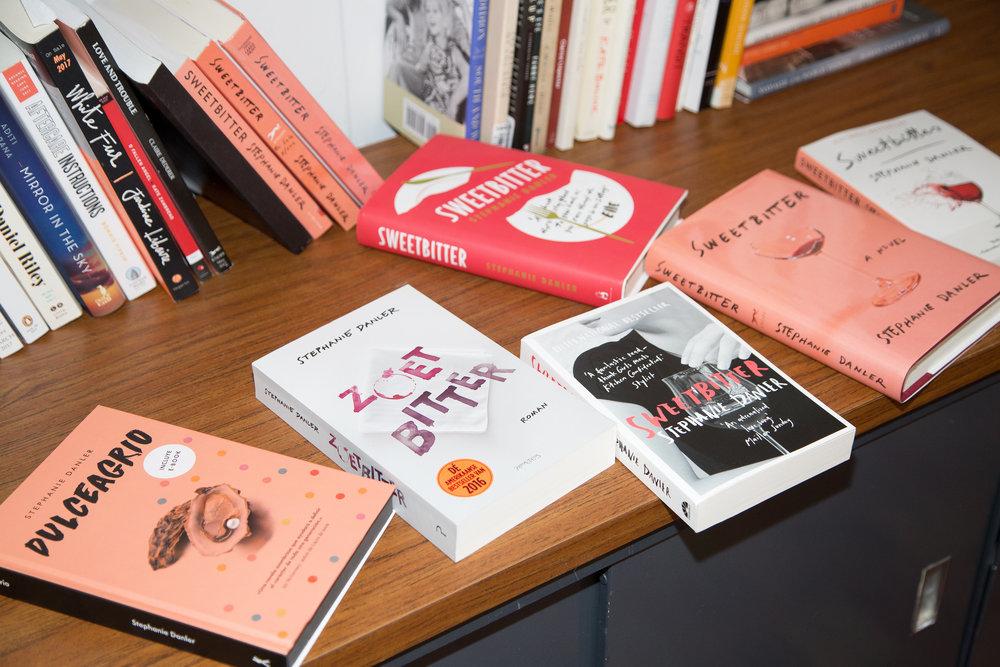 Copies of various versions of Stephanie's book, Sweetbitter