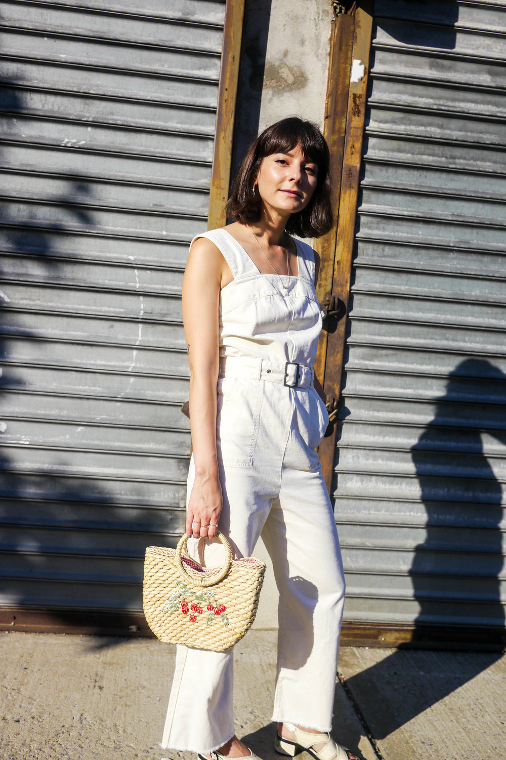 Streetstyle Details:    Jumpsuit, ASOS    ; Shoes, Urban Outfitters ;    Bag, Lisa Says Gah