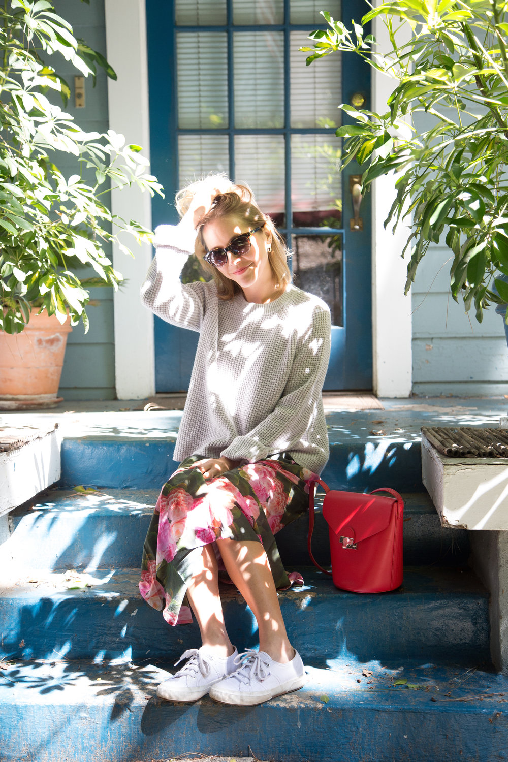 Sweater: Jenni Kayne ,  Dress: The Odells in Silverlake , Bag: Loeffler Randall,  Sneakers: Superga ,  Sunglasses: Warby Parker