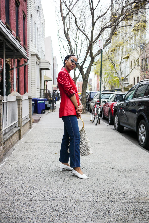 Jacket, Vintage ;  Jeans, Collection LA  ;   Sunglasses, Le Specs x Adam Selman  ;  Shoes, Martiniano