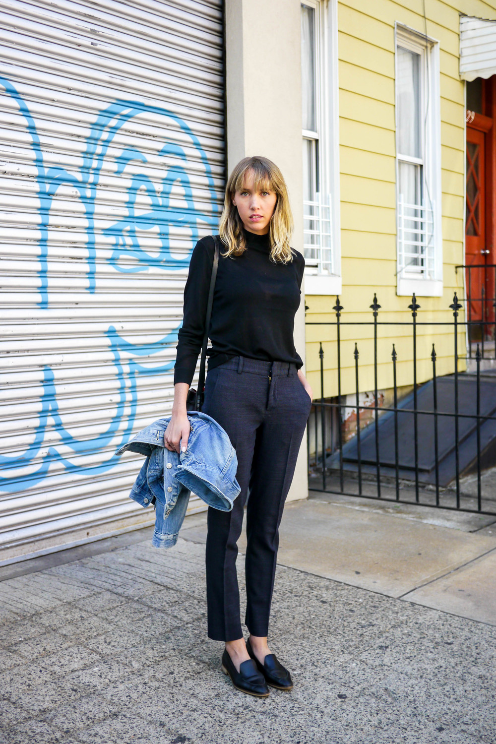 Streetstyle Details:  Top, Everlane  ; Pants, Karen Walker ; Jacket, Levi's ;  Bag, Mansur Gavriel  ;  Shoes, Everlane