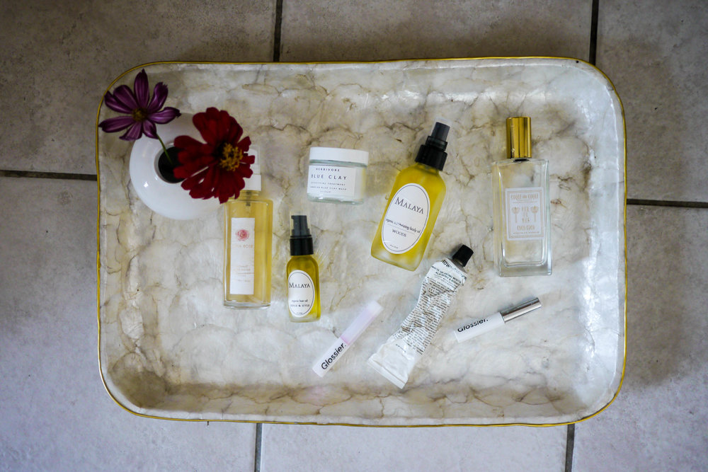 Shiva Rose Venus Amber Body Oil  ,   Generation G Matte Lip in Crush ,  Glossier Boy Brow ,    Malaya Hair Oil ,  Herbivore Blue Clay Mask ,  Malaya Moisturizing Body Oil ,    Grown Alchemist Matte Balancing Moisturizer ,  Coqui Coqui Bath Oil Maderas