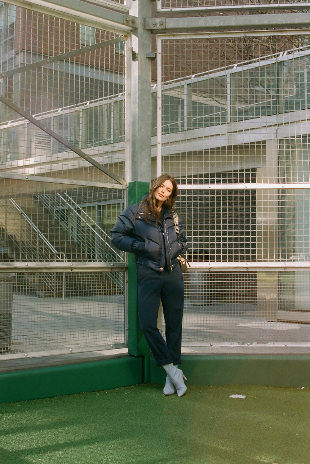 Coat, Cordova ; Jumpsuit, Isabel Marant ; Boots, Stuart Weitzman, Bag, Marc Jacobs