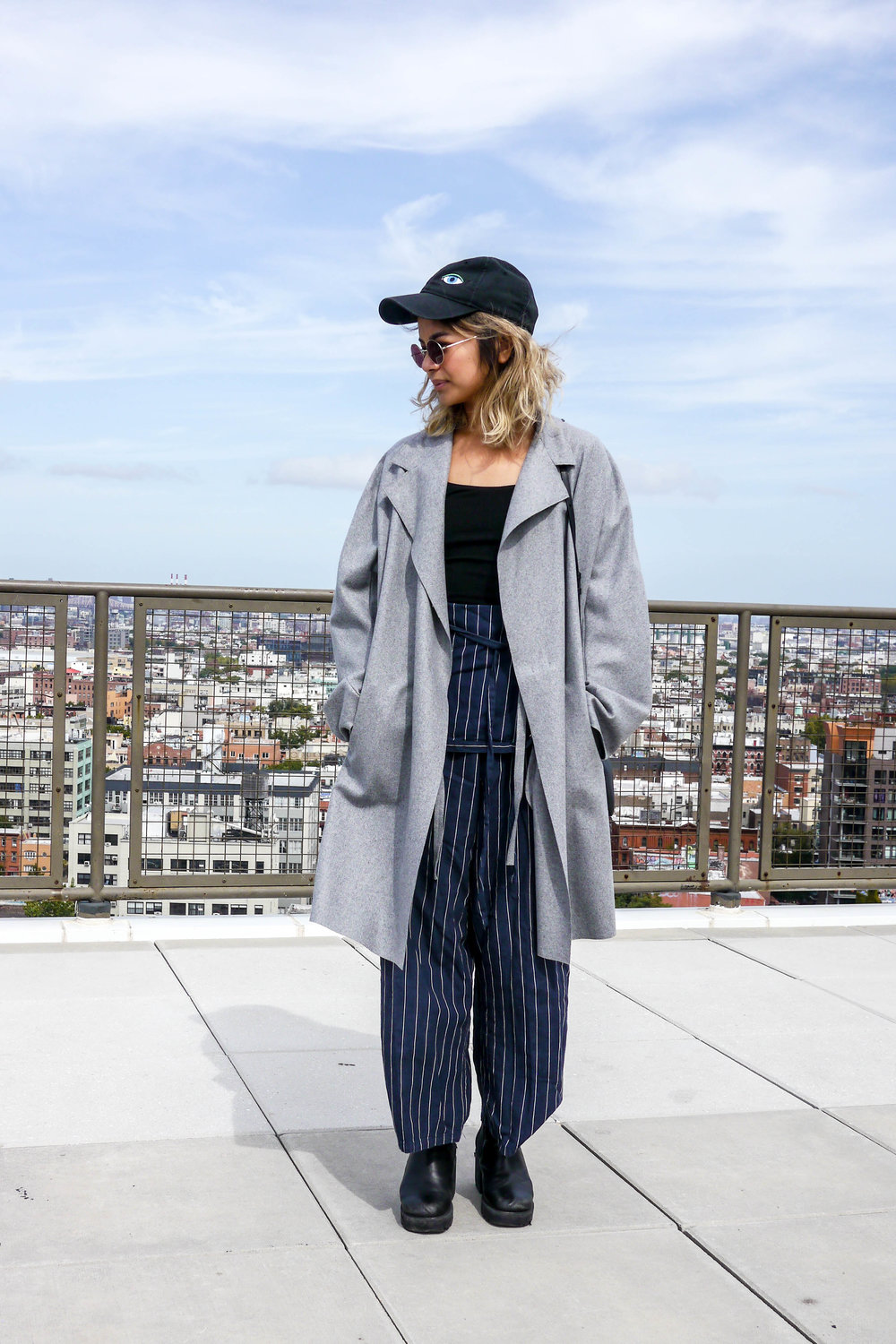 top, reformation    ; jumpsuit, chloe sevigny for opening ceremony ;    coat, acne    ;    boots, asos    ;    bag, celine    ; sunglasses, warby parker; hat, opening ceremony