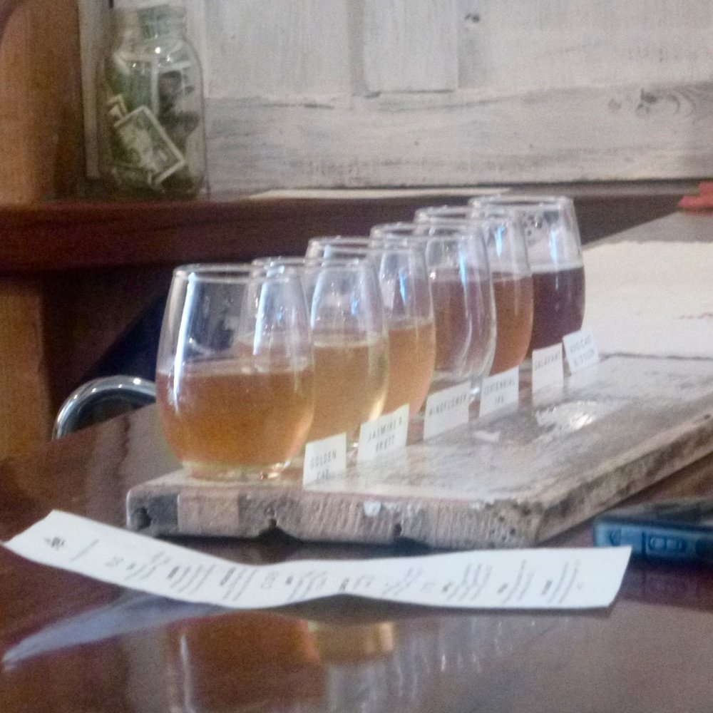 Nine taps: Flights of 6 are served on repurposed bee box parts.