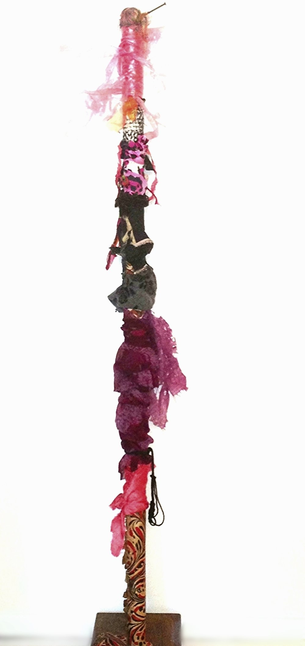 """Wedding Dancer   Recycled textile, Japanese cellophane, rust, vintage thread spool, acrylic, paper, yarn, ribbon, cord, on industrial cardboard tube.  57 x 12"""" round  2015-2018"""