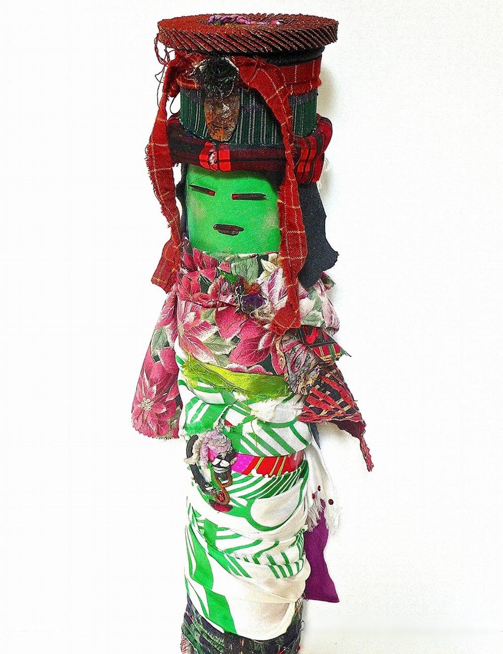 Foreigner.  Textile, rust, sanding disk, paper, yarn, metal, plastic, wood, elastic, glitter on industrial cardboard tube. 22 x 8 in. round (55.88 x 20.32 cm.) 2015