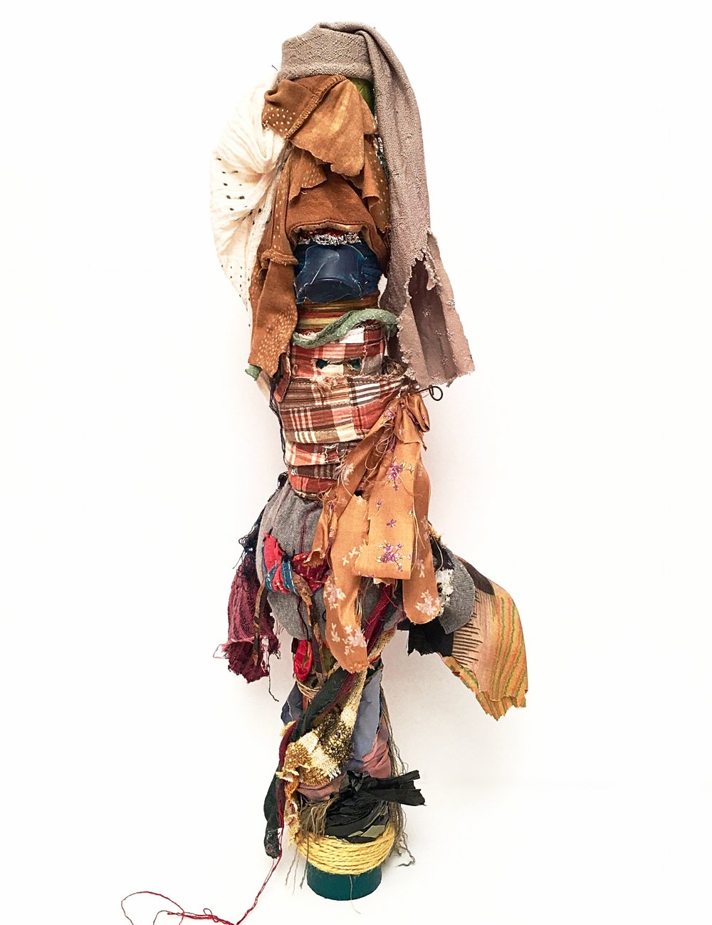 """Tall Hat   Textile, rust, cord, antique India fabric, scraps from Bosnia and Japan, plastic, foil, paper, ribbon, thread, yarn, acrylic on industrial cardboard tube  24½ x 10 x 7½""""  2016-2019"""