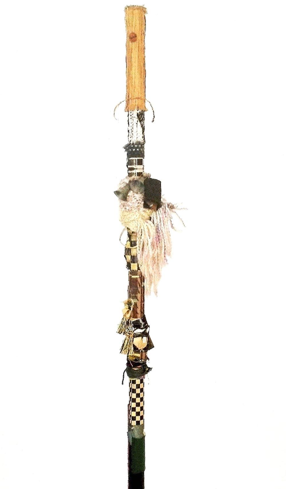 Rhythm Stomp Pole.  Rust, India bells, textiles, paper, camel-tassels, cellophane, yarn, cord, acrylic, felt on industrial cardboard, 55 x 8 in. round (139.7 x 20.3 cm.) 2015