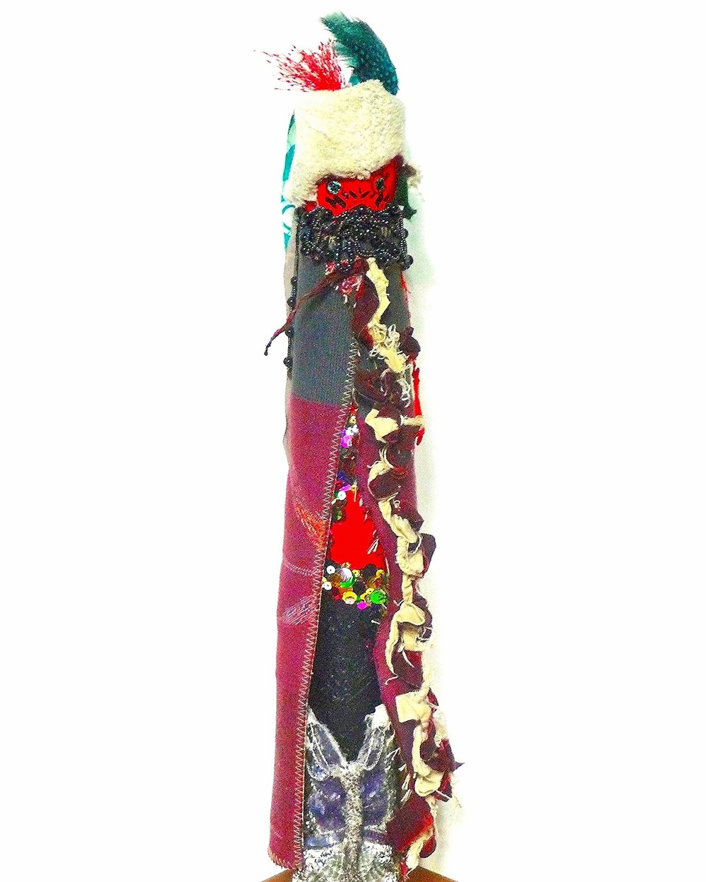 Eagle Eye.  Feathers, beads, sequins, fabric, string, marker, foil, thread, acrylic, vintage applique on industrial cardboard tube. 21 x 4 1/2 in.round (53.3 x 11.4 cm.) 2014