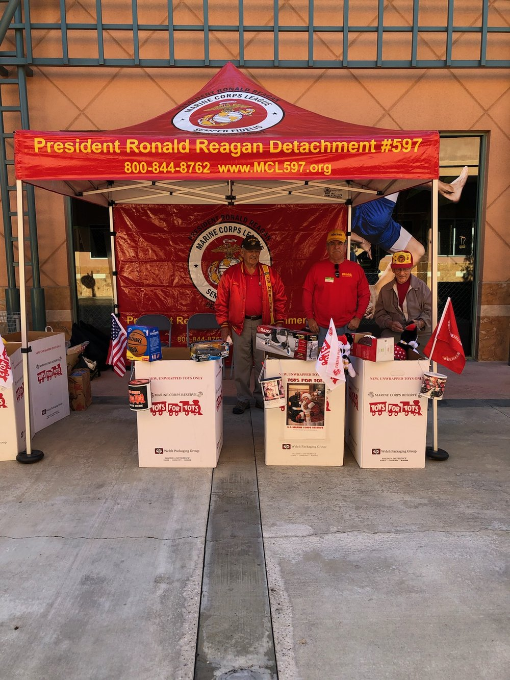Opening the 2018 Toys for Tots Campaign at the Janss Mall in Thousand Oaks.   L/R: John Mitchell, Bob Martinez and Godfrey Harris with Dave Opfer Taking the Picture