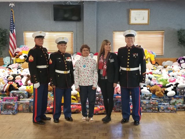 Members of the Detachment accepting over 1000 toys for our Toys for Tots campaign on December 11 at the Elks Lodge in Simi Valley.   L/R: Larry Fischer, Ramon Arevalo, Keri Sears (Toy Donor), April Gisoetti (Exalted Ruler of the Elks Lodge) and Jack Parfitt.