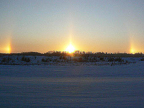 Aniak sundogs-three sunsets at one time!