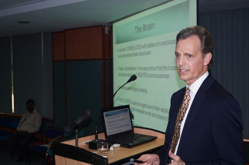 David Wiebers, M.D., delivering Theory of Reality presentation at Amity University Delhi campus on November 9, 2015.
