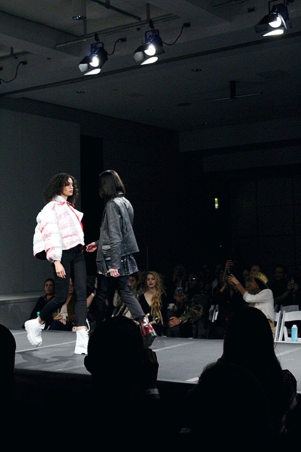 WastedLA  white jacket crossing paths with another model (designer not found)