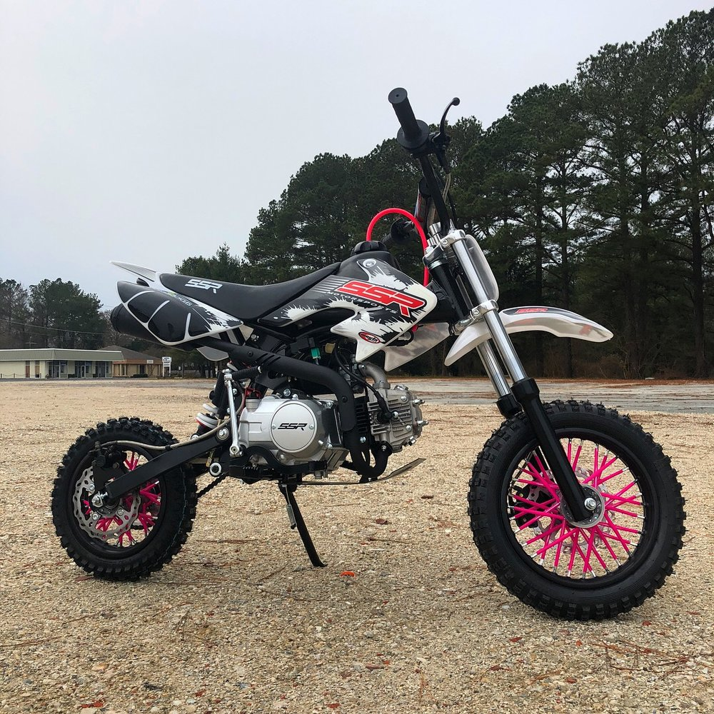 SSR 110cc featuring pink spoke wraps.
