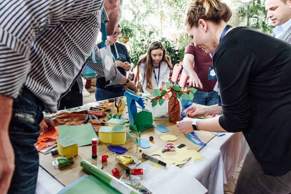 Participants at the Thought For Food Global Summit 2016 imagine the future relationship between farm and city using simple craft materials.