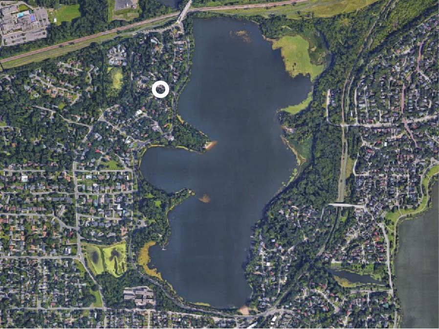Aerial view of Cedar Lake. The Stack House is a modern architect designed home by the Lazor Office architecture firm in Minneapolis, MN. The house is located on Cedar Lake in Minnesota.
