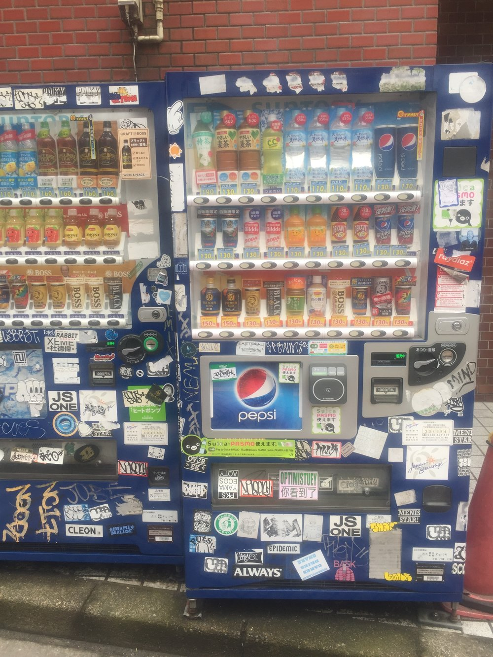 stickers on a vending machine in tokyo shibuya.JPG