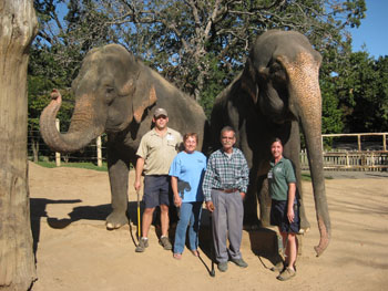 Justin Smith, Linda Reifschneider, Richard Lair and Jenni Bowman with elephants Jewell and Zina at the Little Rock Zoo