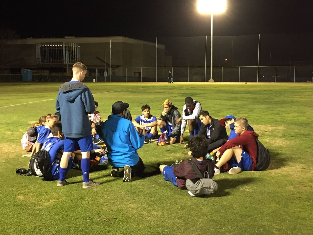 Here is a picture of the 2016-2017 boys soccer team in a half-time huddle.