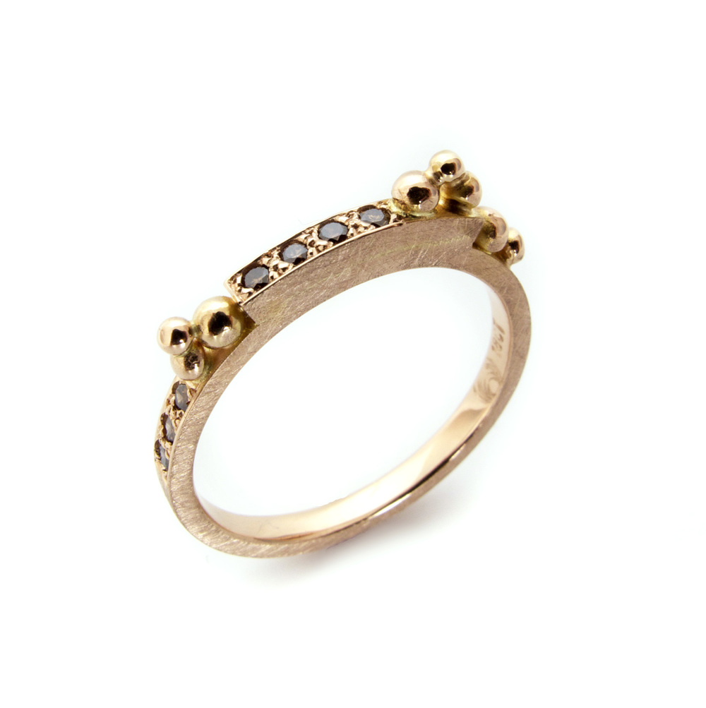 Adding to the collection at Arbor Brunswick, this 18ct rose gold granule ring with grain set champagne diamonds