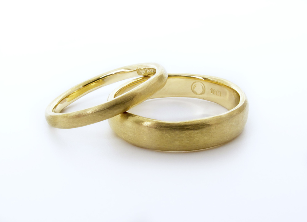 And from the same job, the two his & hers wedding bands pictured on their own, 18ct yellow gold with a soft organic texture.