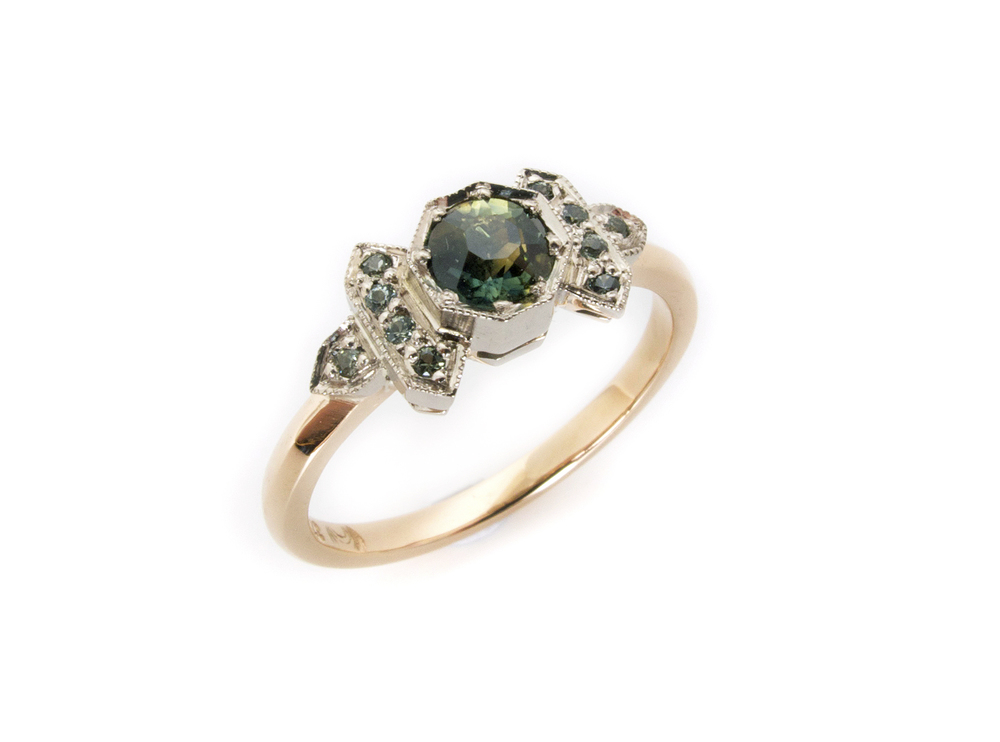 Another art deco inspired ring but with a more classic construction, this piece featured the customers own Australian parti sapphire from an antique brooch, with the addition of tiny green sapphires in 9ct rose and grey golds.