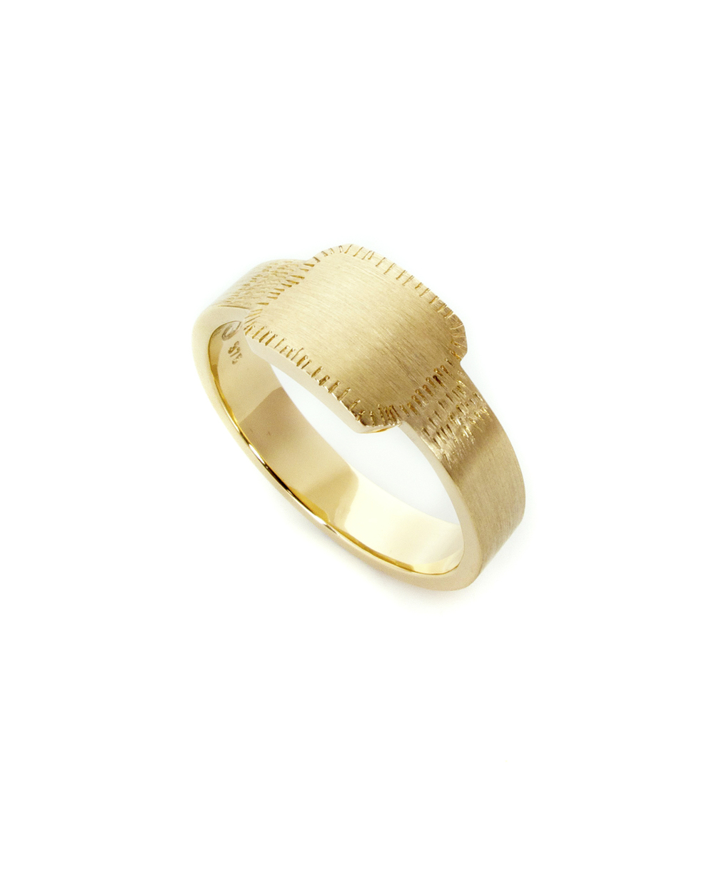 this is a classic signet style band, with the added twist of some fine hand stamped detail.  In 9ct yellow gold.