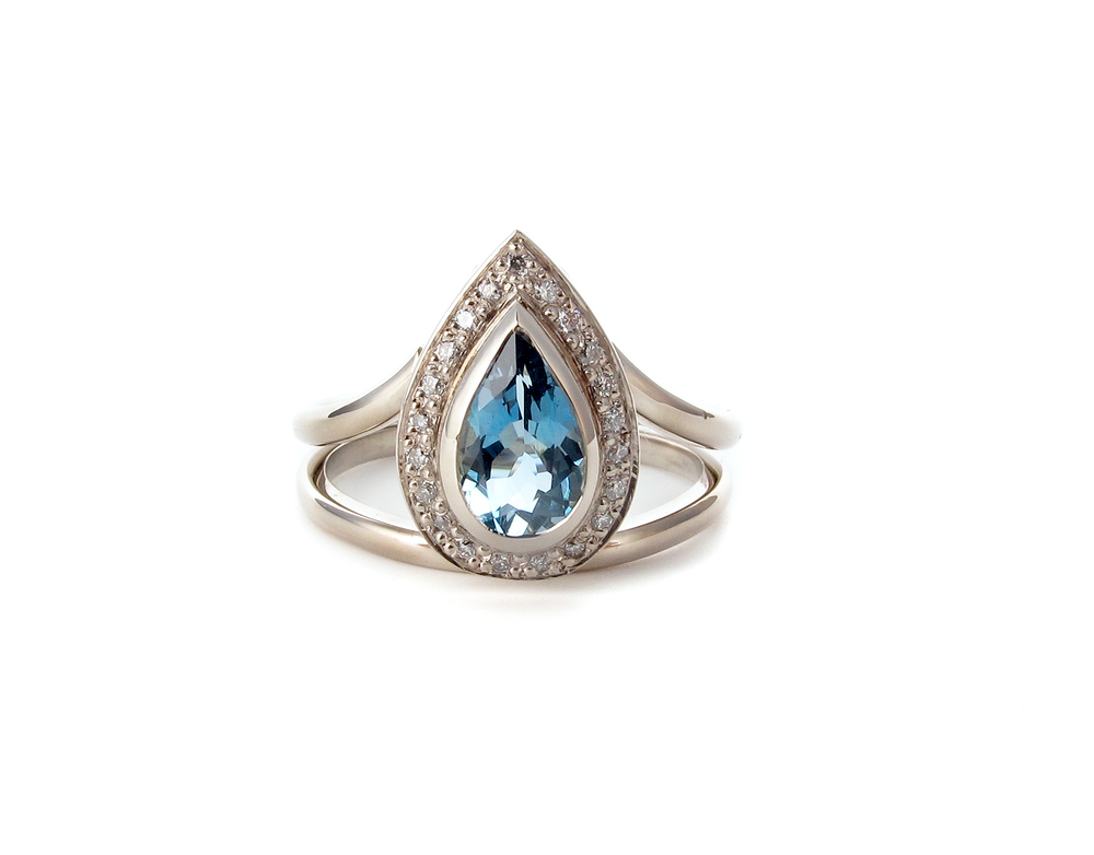 pear shaped aquamarine and diamond engagement ring in 9ct white gold