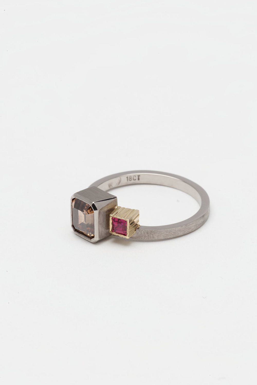 One of my first engagement rings and the beginning of my obsession with two stoned rings.  Cognac diamond and ruby in 18ct white & yellow gold, 2010