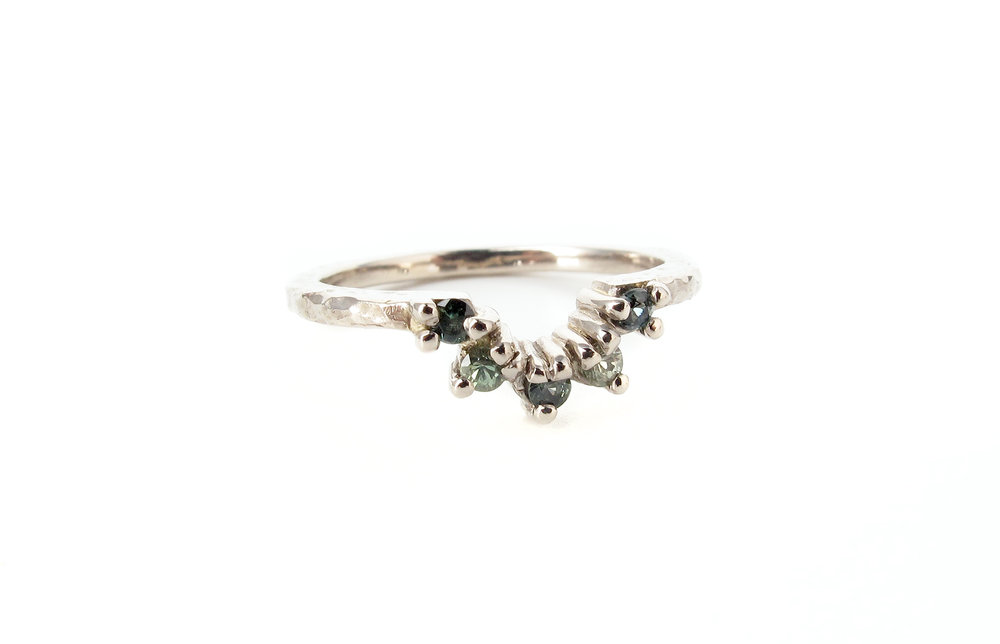 claw set green sapphire wedding ring