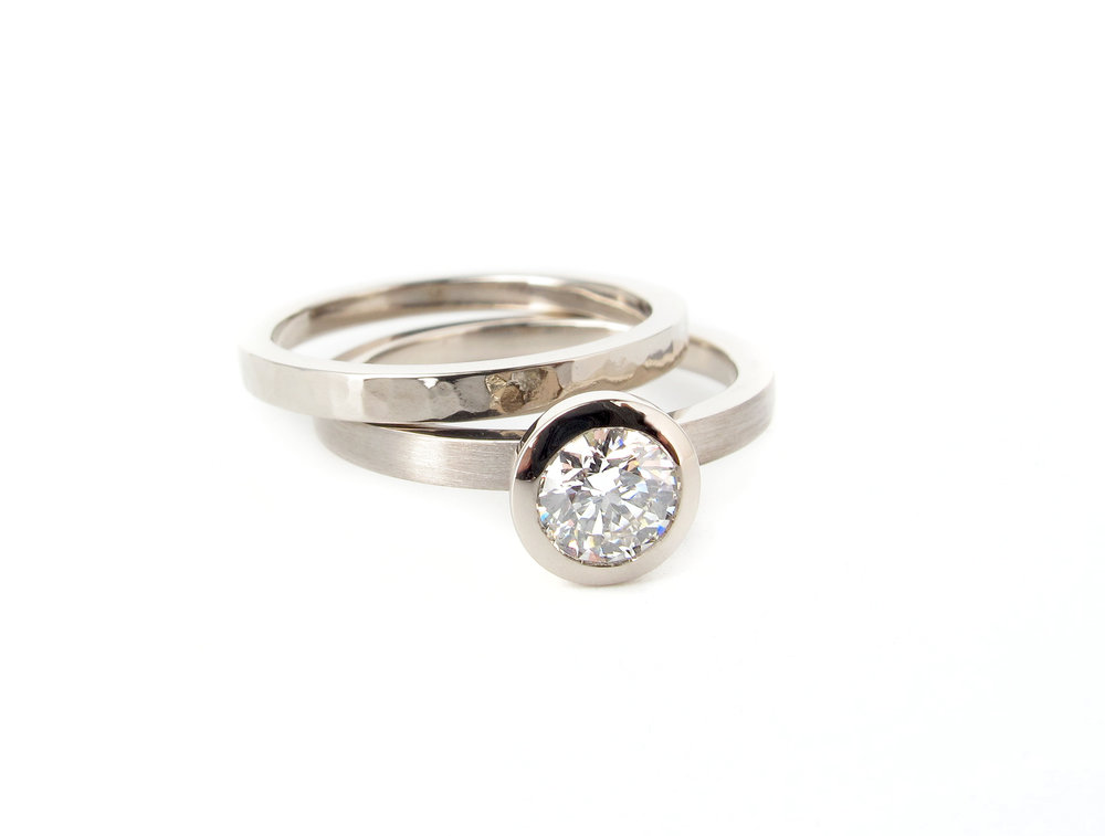 Round brilliant cut diamond solitaire engagement and wedding ring with hammered finish