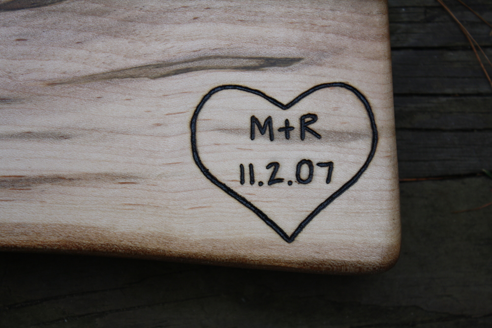 Heart engraving with initials and date