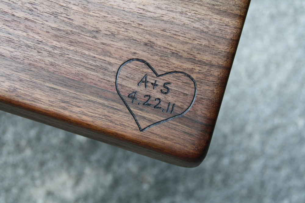 Heart engraving with initials and date on Black Walnut
