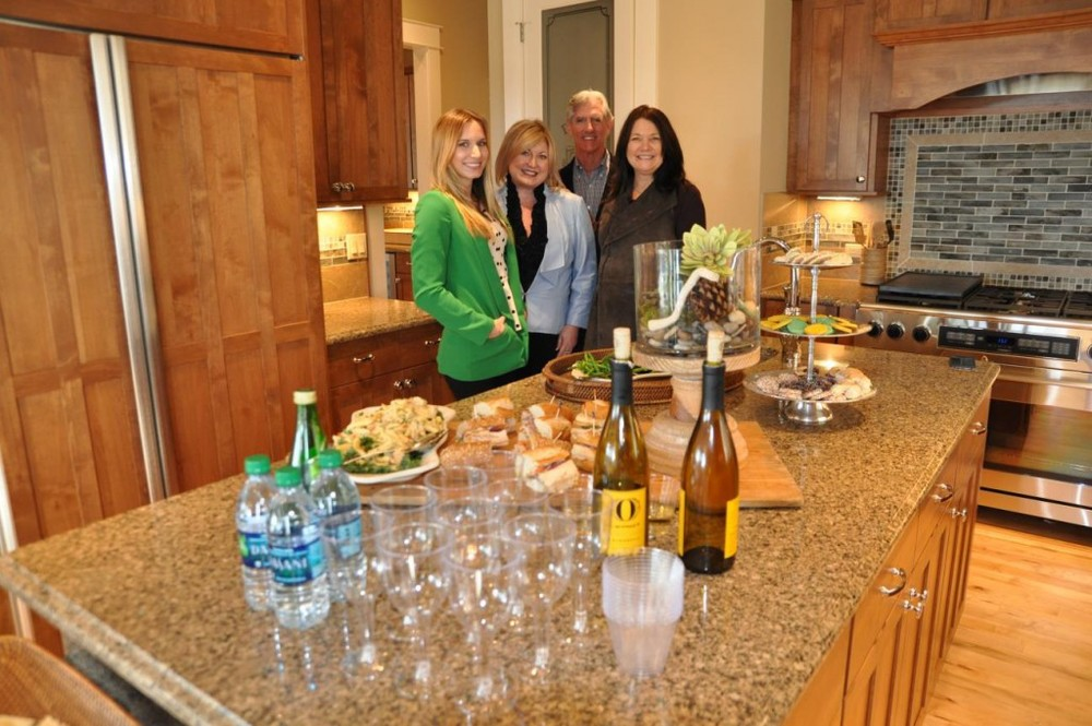 PICTURED ABOVE AND BELOW: The sales team at Vista View Estates puts on a great spread of fresh foods and wine tastings befitting of living in the wine country at Mondavio.