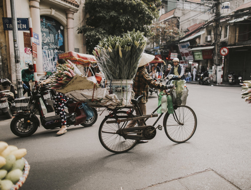 Travelling through Hanoi with flowers