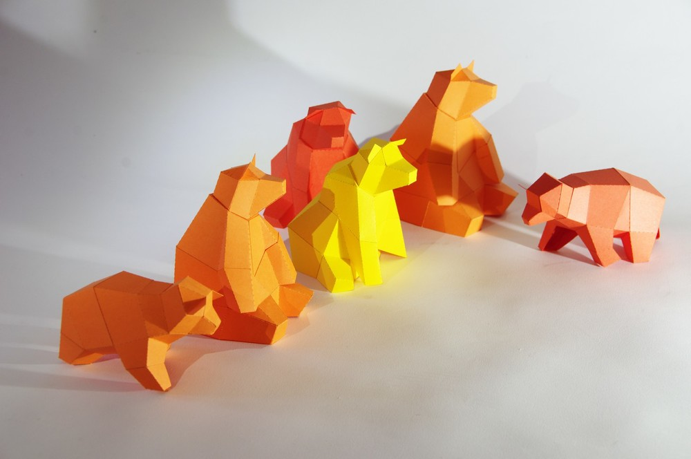 "Mini Papercraft Kits ""Sitting Bear Family"", developed for a group event. Each bear consists out of 2 elements and no instructions at all. Participants where still able to put together the animals."