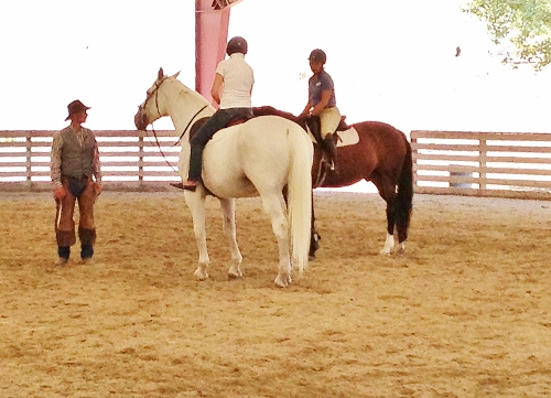 teaching two riders (500x361).jpg